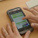 A respondent participates in a mobile optimized survey on their smartphone.