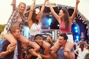A group of young people at a concert. If conducting CAPI research outside, be aware of bright lighting and noise.